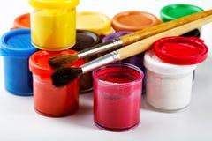 Jars of gouache and brush Stock Photo