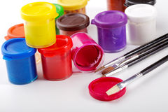 Jars of gouache and brush Royalty Free Stock Photography