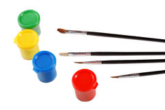 Jars of gouache and brush on a white Royalty Free Stock Image