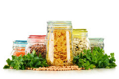 Jars with grain foods on white Royalty Free Stock Photography