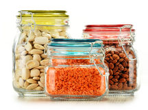 Jars with grain foods on white Stock Photos