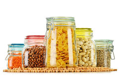 Jars with grain foods on white Stock Images