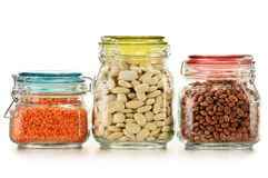 Jars with grain foods on white Royalty Free Stock Image
