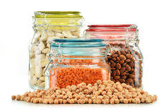 Jars with grain foods on white Stock Photo