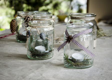 Jars handmade lanterns. On the tablecloth Royalty Free Stock Photography