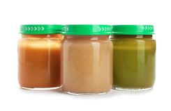 Jars with healthy baby food. On white background Royalty Free Stock Image