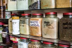Jars of herbs and powders in a indian spice shop. Royalty Free Stock Photography