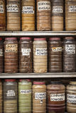 Jars of herbs and powders in a indian spice shop. Stock Images