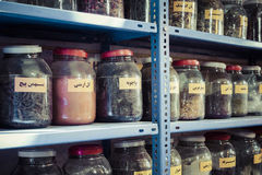 Jars of herbs and powders in a iranian spice shop. Jars of herbs and powders in a iranian spice shop Royalty Free Stock Photography