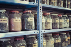 Jars of herbs and powders in a iranian spice shop. Jars of herbs and powders in a iranian spice shop Stock Photos