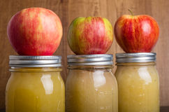Jars of homemade applesauce with apples Royalty Free Stock Images