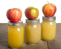Jars of homemade applesauce with apples Royalty Free Stock Photos