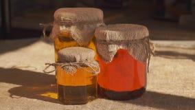 Jars of honey. Different types of honey. Closeup stock footage