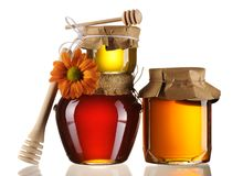 Jars of honey and dipper royalty free stock photography