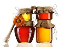 Jars of honey and dipper Stock Image