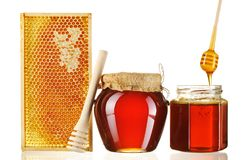 Jars of honey and dipper Stock Photography
