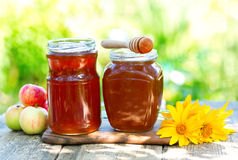 Jars of honey on wooden table Stock Photography