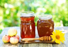 Jars of honey on wooden table Royalty Free Stock Image