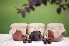 Jars of jam. And cherries Royalty Free Stock Image