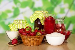 Jars of jam, basket with strawberry Stock Photo