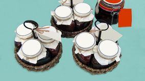 Jars of jam in baskets Royalty Free Stock Photos