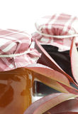 Jars of jam and leaves with red nuance Royalty Free Stock Photos