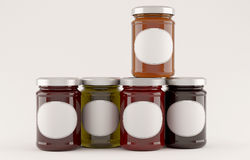Jars of jam over white background Stock Photography