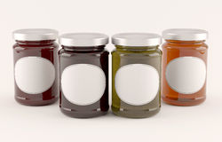 Jars of jam over white background Stock Image