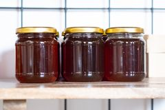 Jars of jam on the shelf in the store royalty free stock photos