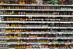 Jars of jam on shelves in the supermarket. Royalty Free Stock Photos