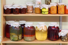 Jars of jam, stewed, braised meat and pickled mushrooms Stock Photography