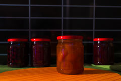 Jars with jam on the table. On black background Royalty Free Stock Image