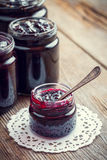 Jars of jam on wooden kitchen table. Royalty Free Stock Photo