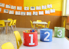 Jars with large lettering one two and three. Red Green and blue jars with large lettering one two and three on the table in the kindergarten class stock images