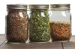 Jars of lentils on a counter Stock Images