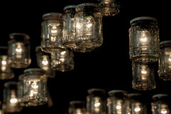 Jars with light bulbs inside Stock Images