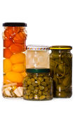 Jars of marinaded vegetables,, isolated Stock Photography