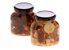 Jars with marinated mushrooms Royalty Free Stock Photography
