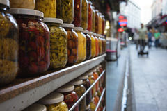 Jars with marinated and pickled vegetables at the market Stock Photography