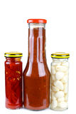 Jars with marinated piquant vegetables Stock Photo
