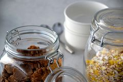 Jars with muesli and cornflakes royalty free stock images