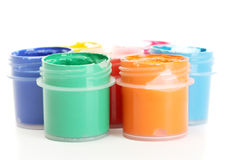Jars with multicolored gouache Stock Images