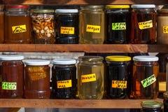 Jars of natural Bulgarian honey. Jars of honey at rural market in Bulgaria Royalty Free Stock Images