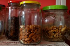 Jars with nus and almonds royalty free stock image