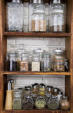 Jars with nuts, dried fruits, spices, herbs and others on kitche Stock Photo