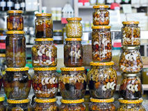 jars with nuts and honey on display in a store Stock Images