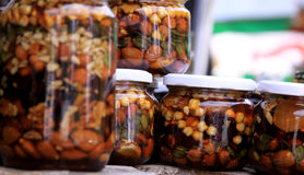 Jars with nuts in honey. Stacked royalty free stock photos