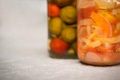 Jars of organic pickled vegetables. Marinated food. Stock Photos