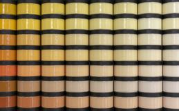 Jars with paint for repair various shades royalty free stock image