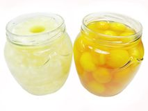 Jars of papaya in syrup and pineapple preserves Stock Images